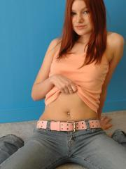 Redhead teen Kori Kitten nipping in her peach top