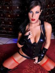 Kortney Kane dresses up in leather and fondles her pussy