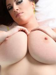Busty babe Lana Kendrick shows you her big natural boobs in bed