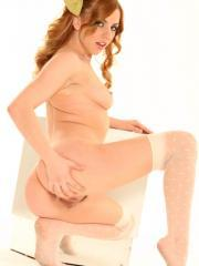 Pictures of Lexi Belle teasing with red hair and stockings