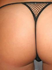 Lili loves showing off her perfectly round ass in a tiny black mesh thong