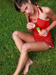Pictures of teen cutie Little Caprice masturbating in the back yard