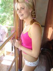 Blonde teen Little Summer teases in her white panties on the patio