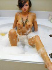 London Hart playing in her bathtub