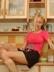 Pictures of Lovely Anne masturbating in a pink shirt and socks