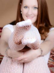 Lucy Ohara wears a white crotchless bodysuit while she fingers herself