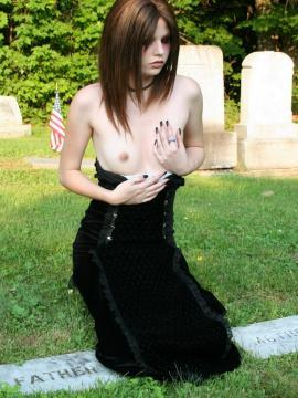 Luna shows off petite tits at cemetary