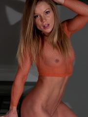 Blonde babe Madden poses in her sexy orange mesh