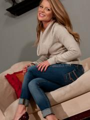 Blonde babe Madden strips in her sweater and jeans