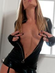 Blonde babe Madden teases in her black latex