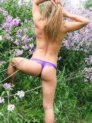 Blonde babe Madden strips out of her pretty dress in the field