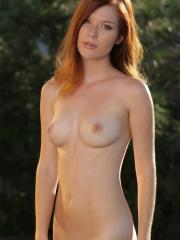 Beautiful redhead Mia Sollis strips completely naked and shows you her super tight body