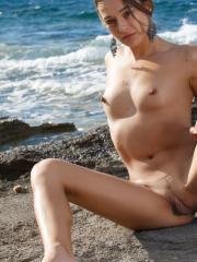 Beautiful girl Dominika A strips off her bikini outside