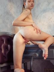 Kimberly Kace displays her slender body, long legs and pink pussy on the chair
