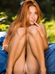 "Redhead babe Michelle H gets naked for you outside in ""Socuti"""