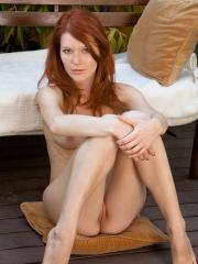 Pictures of stunning redhead Mia Sollis completely naked and spreading her legs