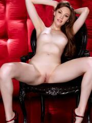 Pictures of hot redhead Aria Amor spreading her legs in red heels