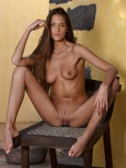 Pictures of Sylvie totally naked and spreading just for you