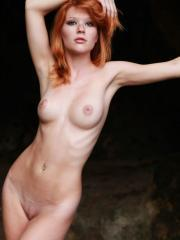 Stunning redhead Mia Sollis flaunts her perfect body and puffy nipples outside