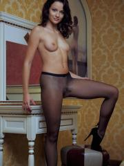 Hot girl Ardelia A slides down her pantyhose to offer you her tight pussy