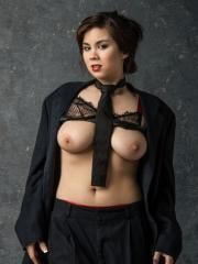 Mai Ly strips out of her business suit to reveal her big natural boobs and wet pussy
