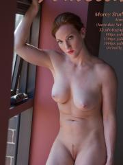 Busty redhead Amelia shows you her nude body
