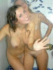 Gallery of two naked lesbians having fun in the shower