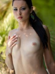 Pictures of Natasha Belle exposing her titties by the pool