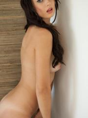 Pictures of Natasha Belle looking sex in her lingerie against the wall