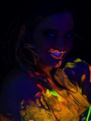 Busty Natasha Shoots A Fun And Sexy Black Light Promo For Her DVD