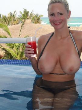 Naughty Allie gets fully nude at a public swimming pool