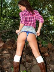 Busty hottie Nikki teases in the woods wearing her plaid shirt and boots