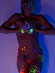 Hottie Nikki Sims gets kinky with the black light and glow sticks