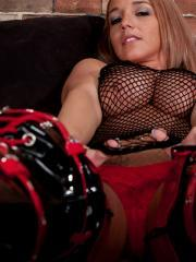 Nikki Sims gives you a hot tease in her red and black boots and fishnet top