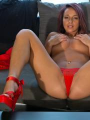 Busty babe Nikki Sims teases in her American Fighter tank and red heels