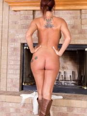 Nikki Sims strips down to her boots in front of the fireplace