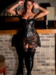 Busty hottie Nikki Sims strips and poses in her black corset