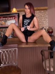 Nikki Sims shows off her sexy legs in a Jack Daniels tank top