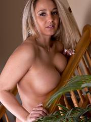 Busty babe Nikki strips for you on the stairs