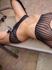 """Busty brunette Nikki Sims poses in """"Aviators And Mesh"""""""