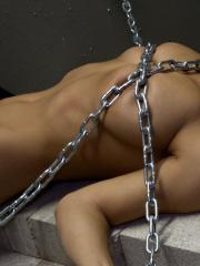 Busty babe Nikki puts on leather pants and chains herself up for you