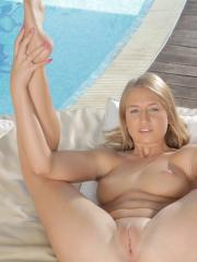 Pretty blonde Milana Blanc tickles her pussy with a tiny pink vibrator