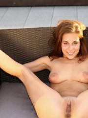Naughty coed Antonia Sainz bends over and shows off her horny pussy