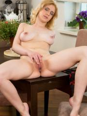 Blonde coed Adelina gets naked for you in the kitchen