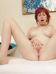 Nubile redhead Zoey Nixon spreads her pink pussy