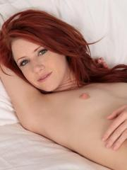 Stunning Nubile Elle Alexandra spreads her shaved pussy