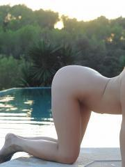 Stunning model Rachel McDonald strips out of her pink bikini by the pool
