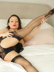 Pinup babe Only Carla teases in her sexy black lingerie