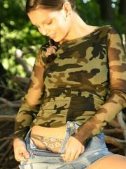 Pictures of Eva stripping out of her camo outdoors