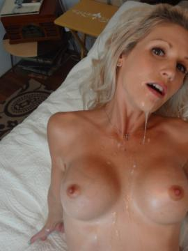 Petite blonde Jolene gets a full load of cum on her chest